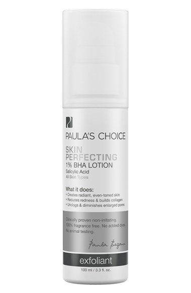 Paula's Choice Skin Perfecting 1% BHA Lotion Exfoliant has a lightweight lotion texture that works to reveal smooth, clear skin by exfoliating both the skin's surface and inside the pore. Because BHA helps reshape the pore lining, it unclogs pores and exfoliates the built-up layers on the outside of skin while improving cell turnover rate. The result is healthier, smoother skin, creating a dramatic improvement in the skin's appearance, feel and function, especially if blemishes are a concern. Research indicates BHA (beta hydroxy acid) increases collagen production and drastically smoothes the surface of the skin. It also has antibacterial properties that attack blemish-causing bacteria. The exfoliant contains no waxy, heavy ingredients and absorbs easily, setting to a soft matte finish. How to use: Apply to clean skin. Dispense a dime-sized amount and massage over face. For daytime, wear under a product rated SPF 15 or higher. 3.3 oz. Fragrance-free; colorant-free. By Paula's Choice; made in the USA. on Belle Belle Beauty